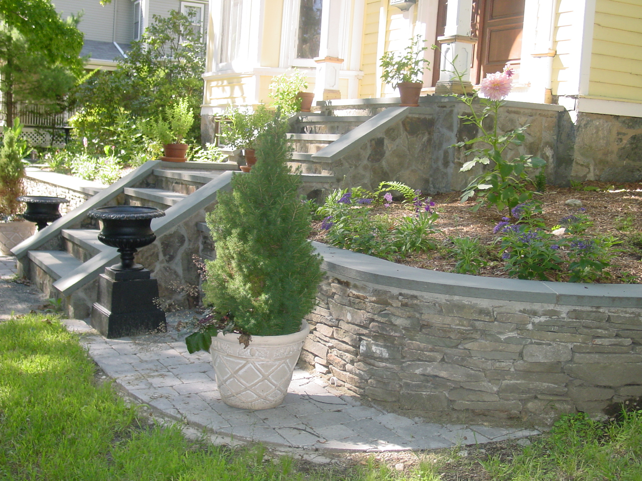 Add beauty in one of the most artistic ways with a hardscape feature.